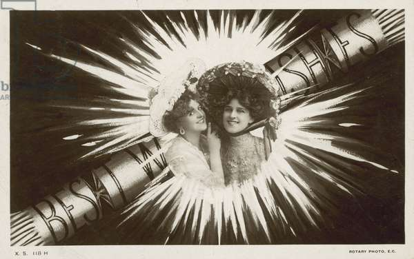 Greetings card with two girls and a cracker (b/w photo)