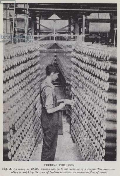 Feeding the loom (b/w photo)