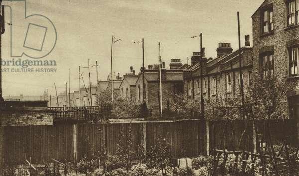 Radio aerials in a London suburb (b/w photo)