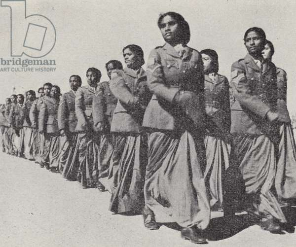 Members of the Women's Auxiliary Force (India) and the Women's Royal Indian Naval Service at a ceremonial parade in Delhi, World War II, February 1945 (b/w photo)