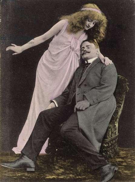 Woman looking over a sleeping man (photo)