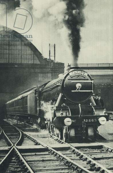 The Flying Scotsman leaving King's Cross Station, London (b/w photo)