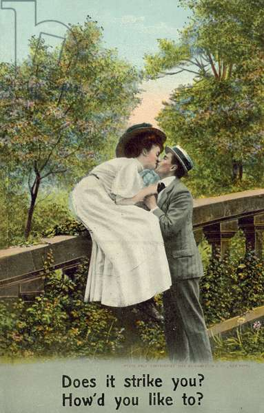 Man and woman kissing, by balustrade (colour photo)