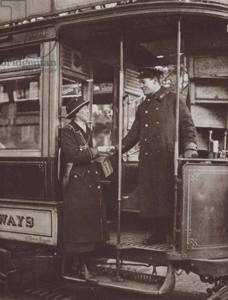 British woman who worked as a tram conductor during the First World War saying goodbye to her driver after her final shift, 1919 (b/w photo)