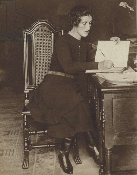 Margot Asquith, wife of the Liberal politician H H Asquith, writing her memoirs, 1920 (b/w photo)