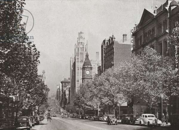 Melbourne: Collins Street looking west, with Town Hall Clock on the right (b/w photo)