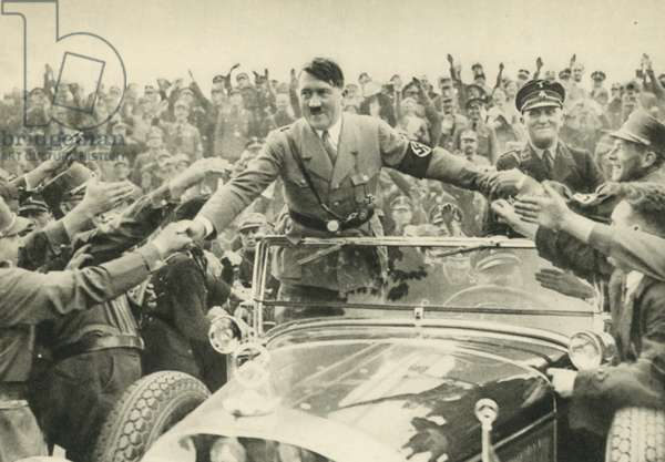 Nazi leader Adolf Hitler acclaimed by his supporters in Nuremberg, Germany, 1933 (b/w photo)