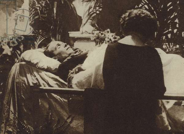 Eva Miller praying by the coffin of actor and film star Rudolph Valentino as he lies in state in the Broadway Chapel, New York, 1926 (b/w photo)