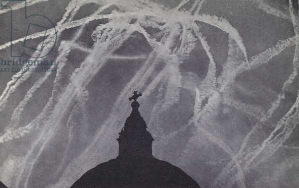 Vapour trails from British and German aircraft in the skies above St Paul's Cathedral during the Battle of Britain, World War 2, 1940 (b/w photo)