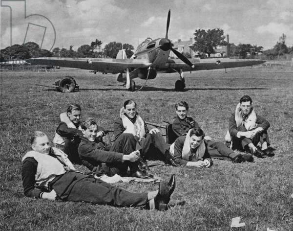 Fighter pilots resting between battles, autumn afternoon, England, 1940 (b/w photo)