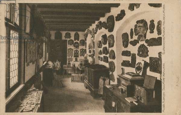 Alsatian Museum with display of wooden sculptures.  Postcard sent in 1913.