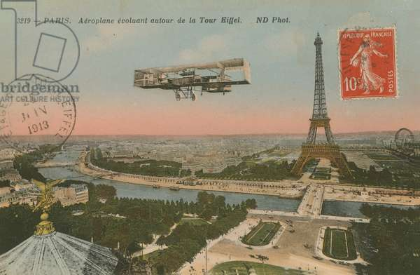 Postcard of an aeroplane circling around the Eiffel Tower, sent in 1913 (hand-coloured photo)