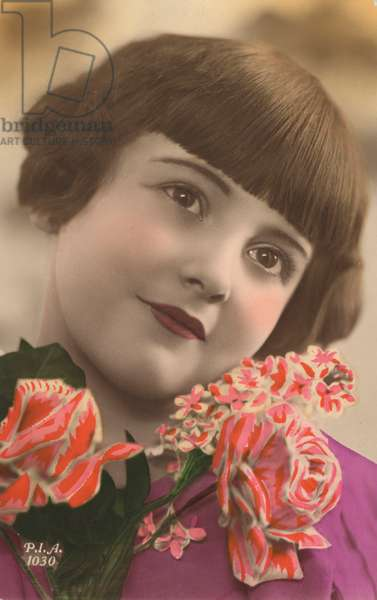 Portrait of a young girl with flowers (photo)