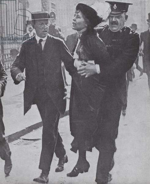 British suffragette Emmeline Pankhurst arrested while demonstrating outside Buckingham Palace, London, 1914 (b/w photo)