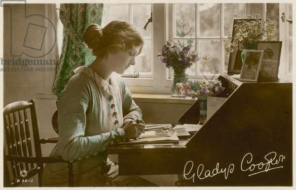 Gladys Cooper at desk (photo)
