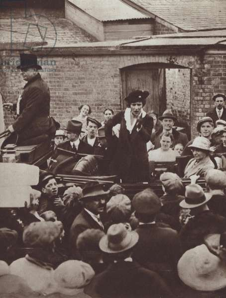 Nancy Astor, the first woman to be elected an MP in Britain, addressing a crowd during the election campaign, 1919 (b/w photo)
