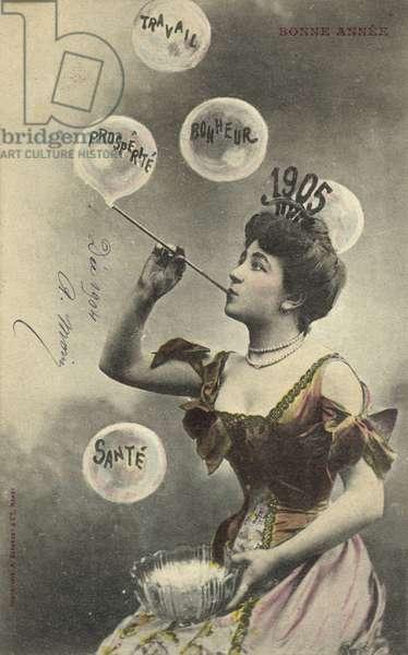 Pretty girl blowing bubbles, for 1905 (colour photo)