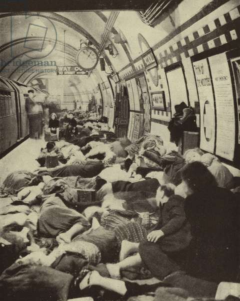 Londoners sheltering from a German air raid on a platform in Piccadilly Underground Station during the Blitz, World War II, September 1940 (b/w photo)
