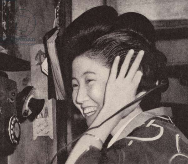 Japanese Geisha girl on the telephone (b/w photo)