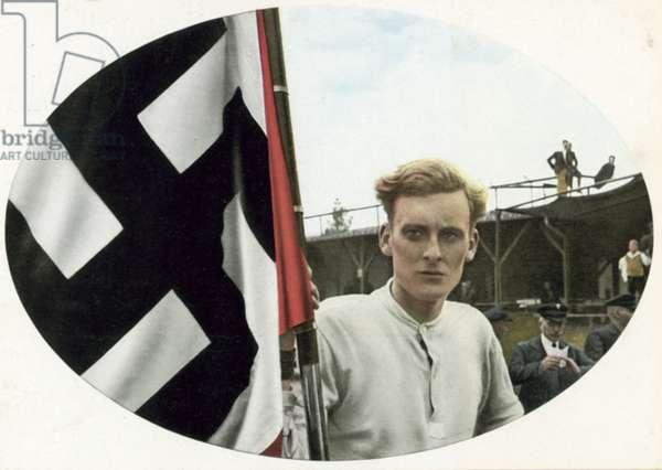 German man with a Nazi swastika flag (colour photo)