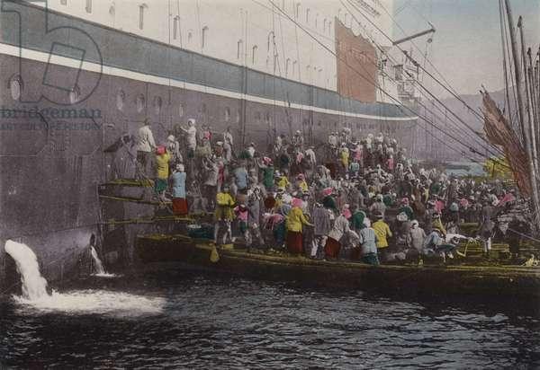 Japan, c.1912: Coaling on the ship at Nagasaki Harbour (photo)
