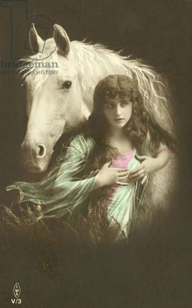 Girl with a horse (colour photo)