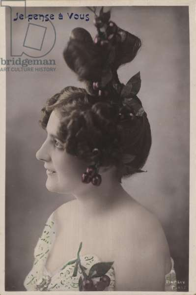 Woman with elaborate hairstyle with cherries (colour photo)