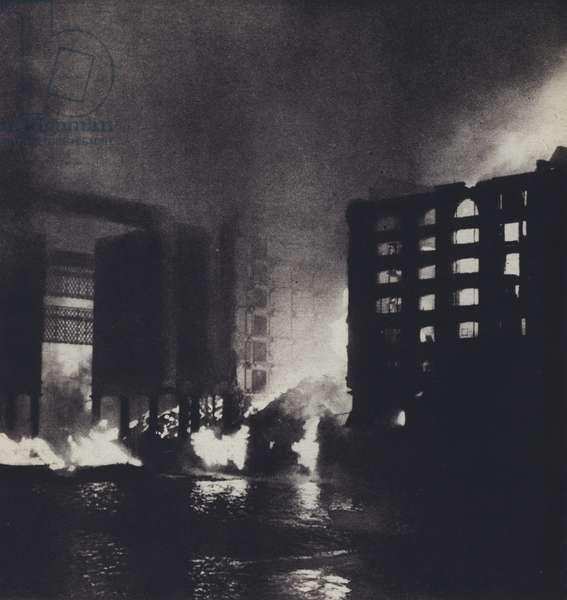 Fires blazing on St Katherine's Dock, London, during the Blitz, World War II, 11 September 1940 (b/w photo)