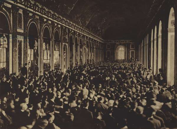 America in World War I: Photograph by a US Army Signal Corps operator of the actual signing of the German peace treaty, in the Hall of Mirrors, Palace of Versailles, 3:10 PM, June 28, 1919 (b/w photo)