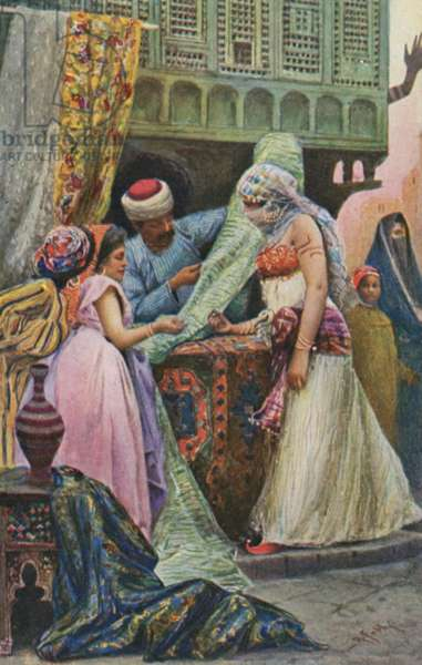 Middle Eastern women buying material (colour photo)