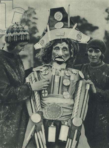Preparing a Guy Fawkes effigy for the bonfire (b/w photo)