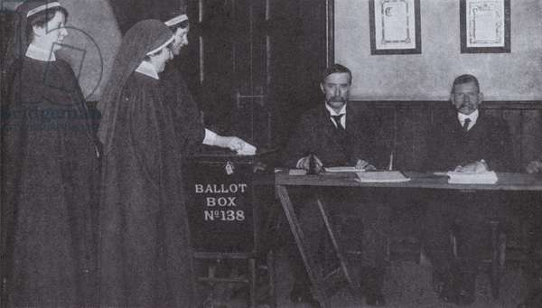 British women voting in a general election for the first time, 1918 (b/w photo)