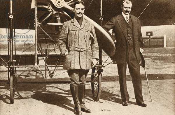 Adolphe Pegoud who, in 1913, became the first pilot to loop the loop, with fellow French aviator Louis Bleriot at Brooklands, Surrey (b/w photo)