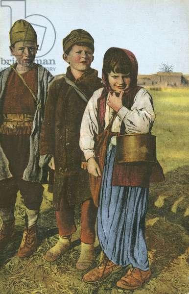 Group of three peasant children (colour photo)