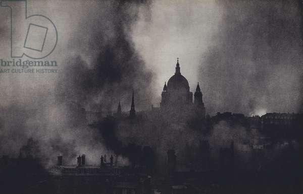 St Paul's Cathedral, London, surrounded by fires and smoke during the Blitz, World War II, 1940-1941 (b/w photo)