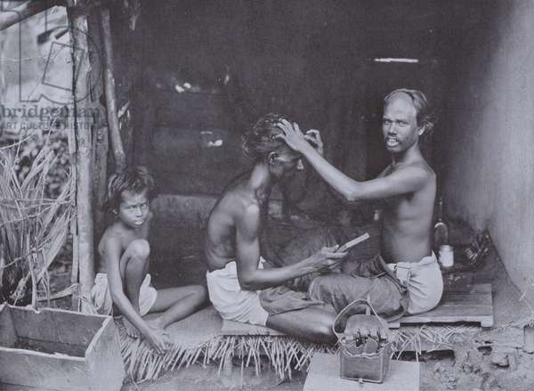 A Ceylon Shave, the Hindoo caste have the head shaved in curious shapes, such as that seen on the barber (b/w photo)