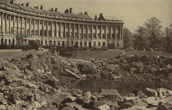 Crater in front of the Royal Crescent, Bath, made by a German bomb dropped during the Baedecker Blitz, World War II, April 1942 (b/w photo)