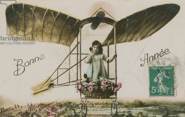 New Year greeting card of a girl in an aeroplane, 1913 (hand-coloured photo)