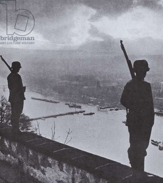 German troops standing guard over the Rhine at Koblenz after the reoccupation of the demilitarized Rheinland, 1936 (b/w photo)