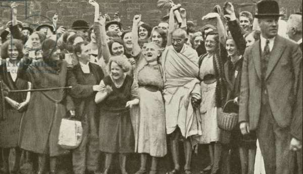 Mahatma Gandhi and cotton mill workers during his visit to Lancashire (b/w photo)