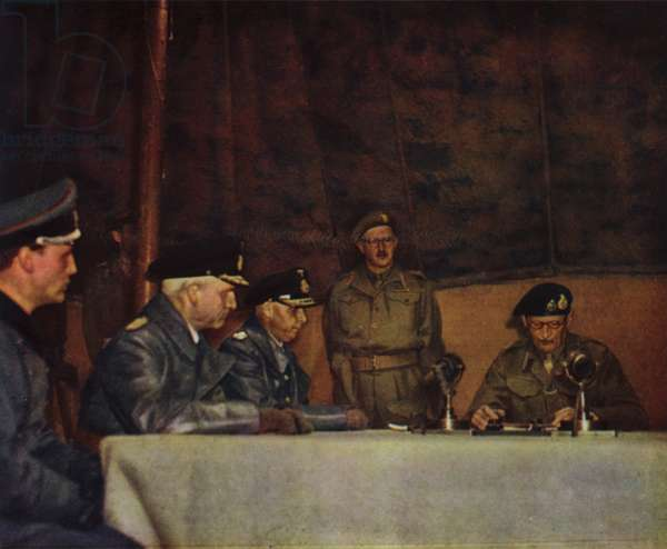British Field Marshal Bernard Montgomery reading the terms of the surrender of German forces in Northwest Europe to Admirals Friedeburg and Wagner, Luneburg Heath, Germany, 4 May 1945 (photo)