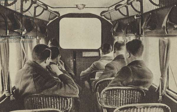 A picture show aboard an Imperial Airways Liner (b/w photo)