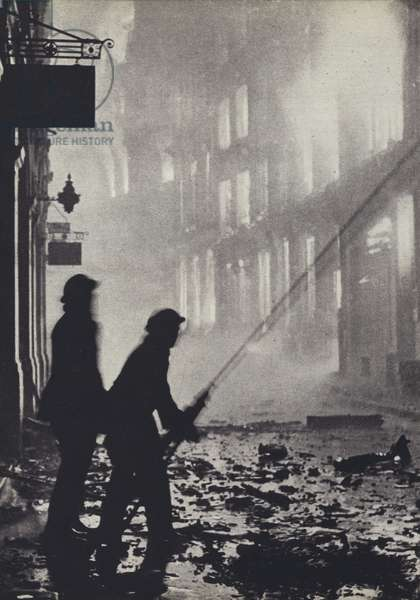 Firemen fighting a blaze in Ave Maria Lane, London, during the Blitz, World War II, 29 December 1940 (b/w photo)