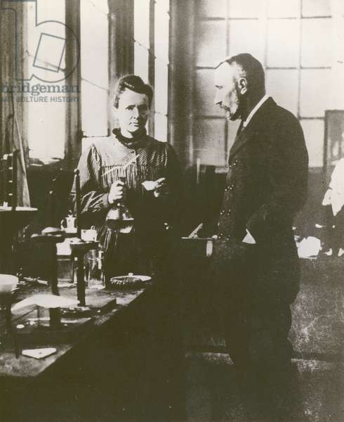 Pierre and Marie Curie, in their laboratory (b/w photo)
