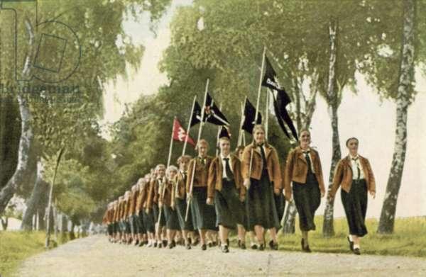 Girls of the Nazi Bund Deutscher Madel (League of German Girls) on a march (colour photo)