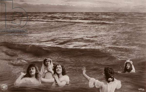 Five clothed women in the sea (photocollage)