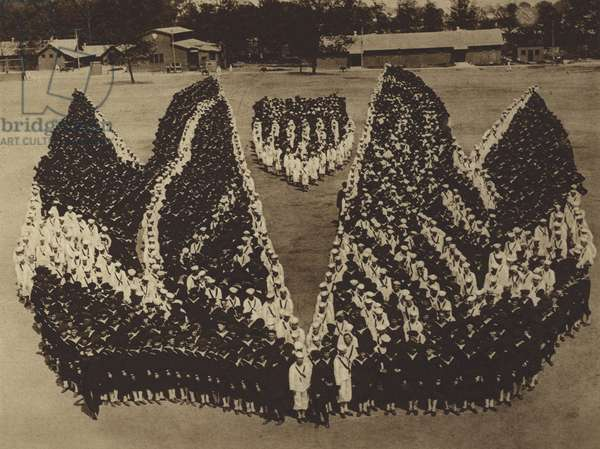 America in World War I: A formation at Pelham Bay Park Naval Training Station to represent the flags of the United States, France, Italy and Great Britain (b/w photo)