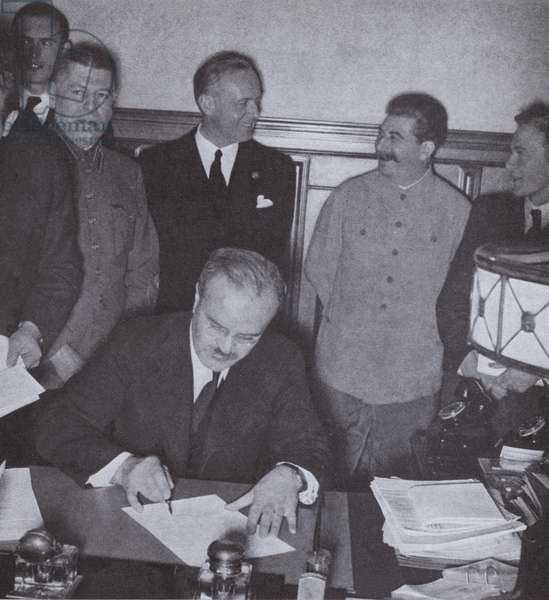 Soviet Foreign Minister Vyacheslav Molotov signing the German-Soviet Non-Aggression Pact, 1939 (b/w photo)