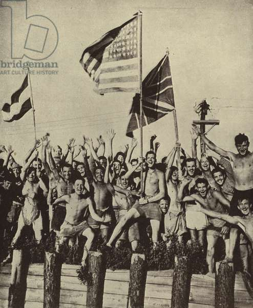 Allied prisoners of war captured by the Japanese in World War II celebrating their release after Japan's surrender, August 1945 (b/w photo)