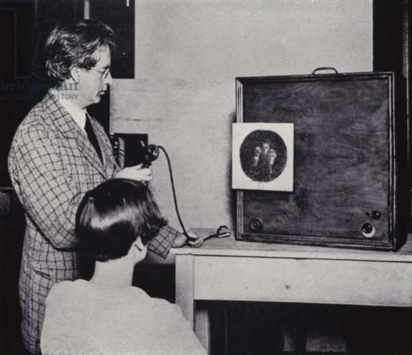 John L Baird giving an early demonstration of television (b/w photo)